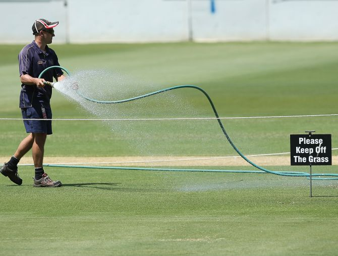 ADELAIDE, AUSTRALIA - NOVEMBER 19: Ground staff water the pitch during a South African Proteas training session at Adelaide Oval on November 19, 2012 in Adelaide, Australia.  (Photo by Morne de Klerk/Getty Images)